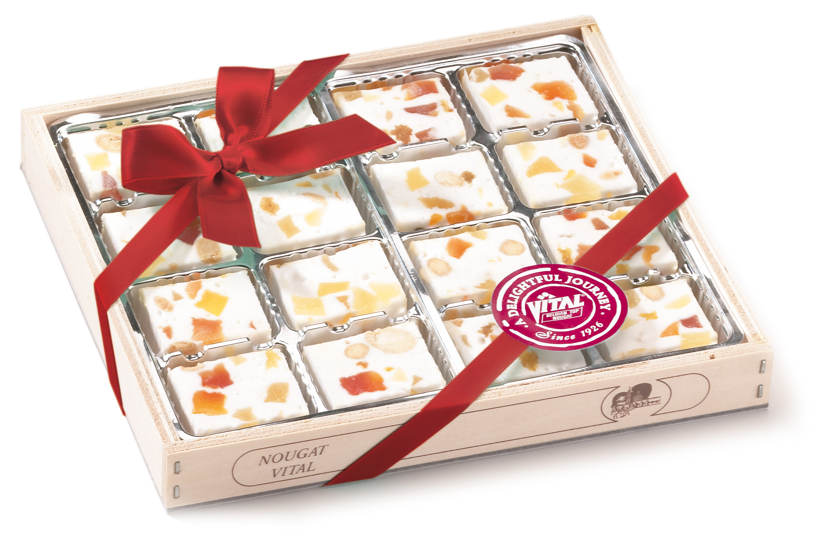 Fruit nougat and vanilla nougat in wooden giftboxes. Almond